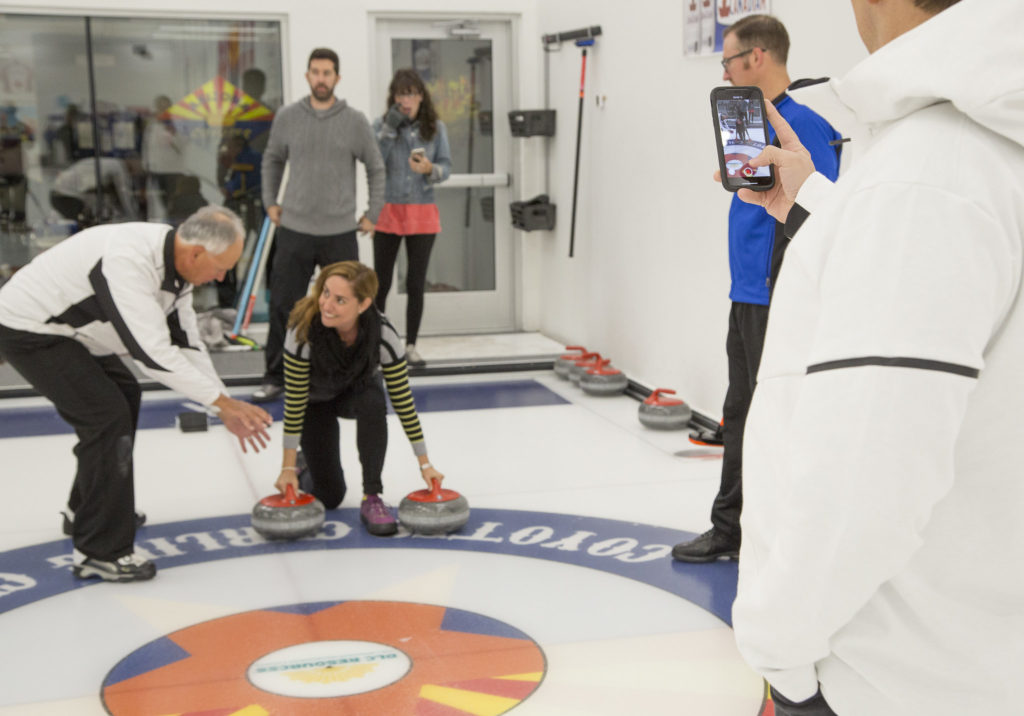 instructor teaching learn to curl