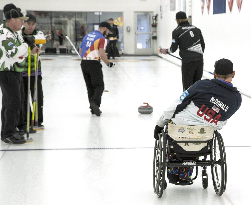 wheelchair curlers on the ice